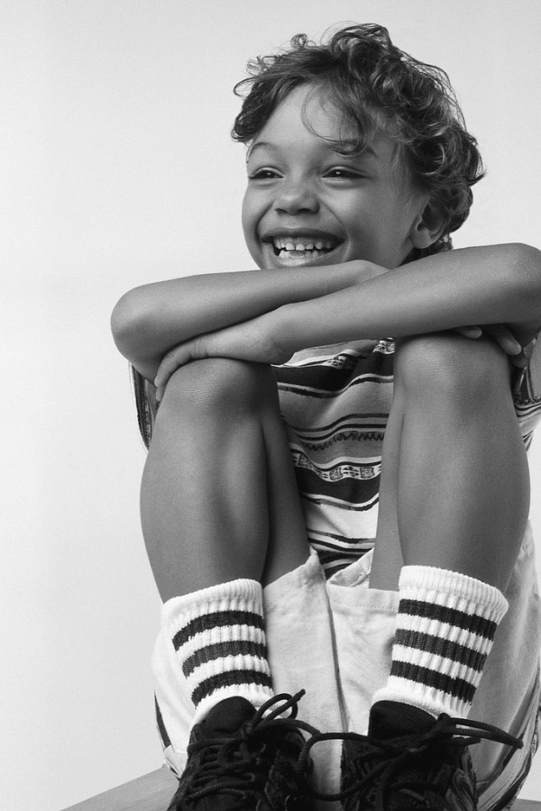1309600336-football+kid+smile.jpg-scaled